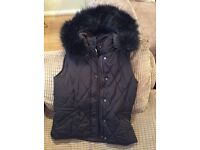Woman's Zara body warmer with tags on