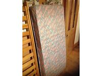 Children's size bed with mattress.