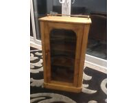 Antique pine music cabinet. Glass front, brass rail. Original shelves. Probably Victorian ?