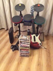 PS3 with full Rock Band set-up and 23 Games