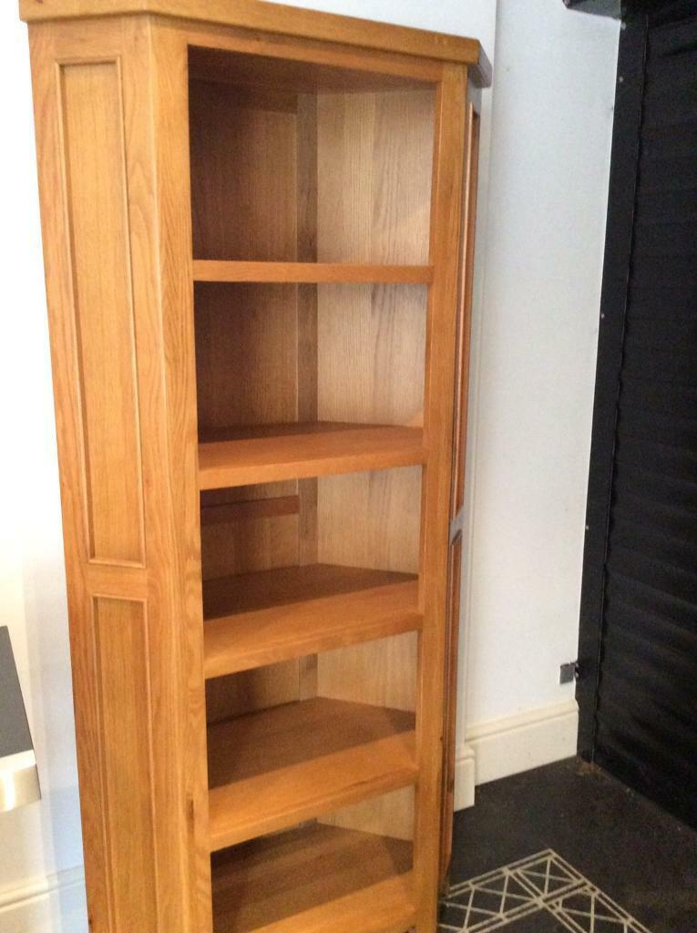 Solid oak tall corner bookcase