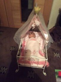 Baby Annabelle in crib with clothes