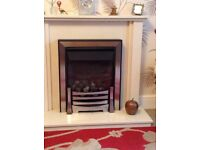 Flue less gas fire with marble surround.