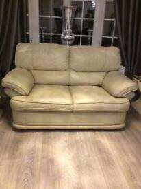 Cream real leather two seater sofa