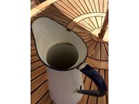White enamel jug with navy trim in French country style
