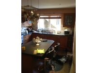 Fully furnished kitchen and utility room with island unit