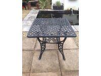 Cast garden table