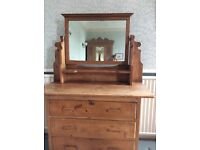 Antique stripped pine dressing table with mirror and wooden handles. 3 drawers and shelf