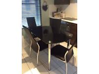 Extending glass table and chairs