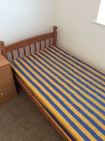 Single wooden bed frame with matress