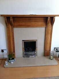 Solid Oak fire surround.