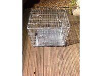 Small metal dog cage