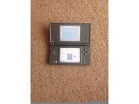 NINTENDO DSI CONSOLE (AS THE BUILT IN CAMERA ) COMES WITH CHARGER AND A GAME / FOR SALE OR SWAPS
