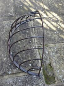 ANTIQUE IRON HAY RACK USED AS GARDEN PLANTER