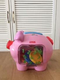 Fisher Price toy, musical piggy bank