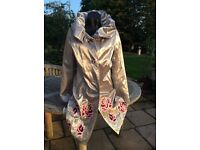 Embroidered silver evening coat