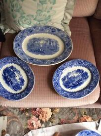 Three blue oval willow pattern plates
