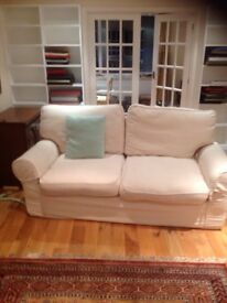 A three seater sofa originally from Laura Ashley with new loose covers
