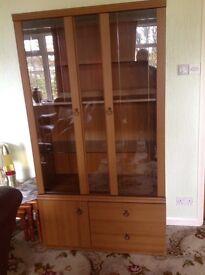 Glass and wood display cabinet 2 glass shelves 1 wood shelf 2 drawers I cupboard
