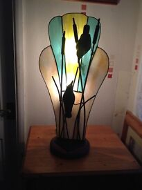 Hand crafted stained glass lamp/ metal,birds on reeds. 23inches tall.