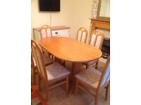 Dining room table with 6 chairs plus sideboard and fire surround.
