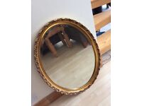 Oval gold guild mirror. 84cm by 56.5 cm Was £500, 10 years ago