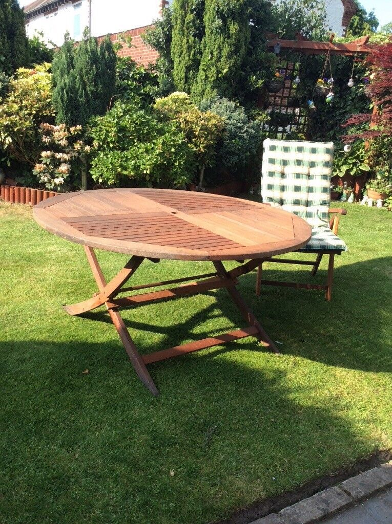Hard wood round garden table with 6 reclining chairs and ...