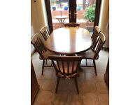 Antique pine extended oval table with six chairs and cushions nice condition