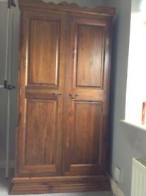 Solid dark wood wardrobe