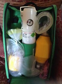 Oxygen cylinder with masks and caring case