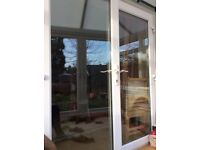 White upvc French patio doors. Very good condition as have been interior of conservatory