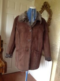 Ladies brown faux suede and fur lined jacket. Size 16/18. New condition.