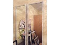 2 sets of mirrored sliding wardrobe doors