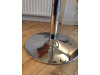 Glass table with stainless still legs