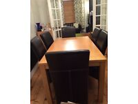 Oak veneer dining table with six faux leather dining chairs