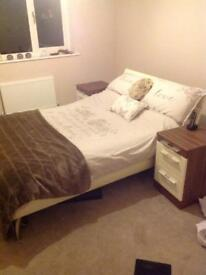Double bed and matching bedside cabinets