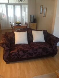 Sofa bed, metal action from DFS. Condition as new. Plum colour with two matching cusion covers.