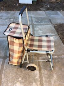 Shopping trolley with seat .
