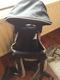 Mothercare black baby carrier with changing mat rain cover and sun cover RRP £45
