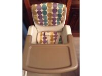 Chicco high chair which fixes to dining chair with straps
