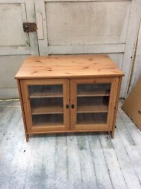 IKEA glass fronted wood finish cabinet.