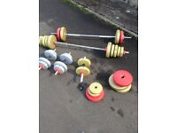 Two bars and three Dumbbells mixture of weights do the job ideal for in the house for a workout.
