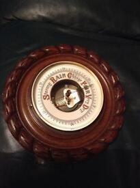 "Antique barometer 10"" diameter in rope twist oak wooden surround £20"