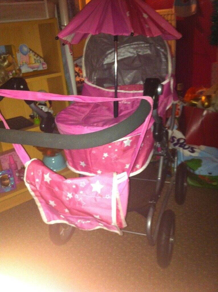 Kids pink dolly pram with acces