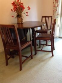 Table, wooden, drop-leaf with three matching chairs
