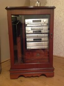 Stereo unit with 2 drawers and CD holder in rich mahogany.