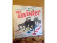 Twister - fantastic party game for ages 6 to 100!! Brand new and still sealed.
