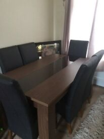 Dining table and 6 leather chairs .