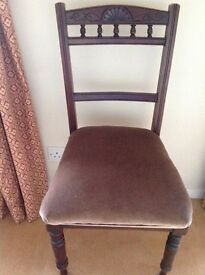 Six dark wood dining chairs with carved backs and padded seats. £70 for the set.