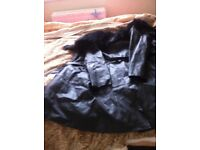 Ladies leather jacket with fur trim collar. Knee length in excellent condition. Worn once. Size 14.